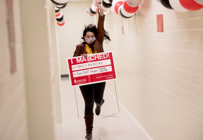 """Divya Kasety runs through a hallway to announce her acceptance to Texas A&M's Family Medicine residency during a """"Match Day"""" event on the campus of University of Incarnate Word's School of Osteopathic Medicine on Friday in San Antonio. Celebrated across the nation, Match Day is the day that students graduating from medical school find out where they will complete their residency. It was the first-ever Match Day at UIW as the inaugural class of 2021 prepares to graduate in May."""