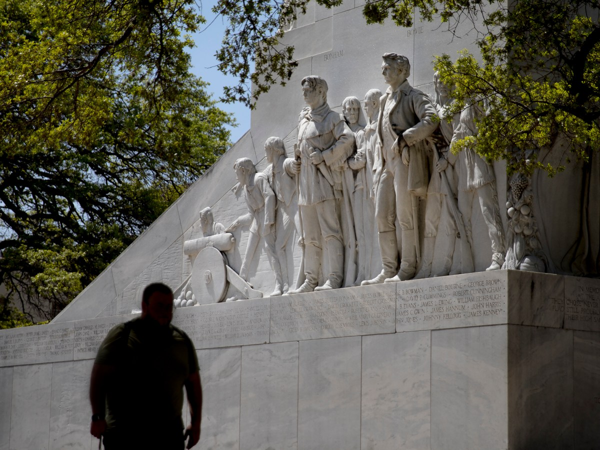 A man walks past the Alamo Cenotaph on Tuesday. Also known as The Spirit of Sacrifice, the Cenotaph commemorates the Battle of the Alamo and bears the names of the Texas rebels known to have fought in the battle.