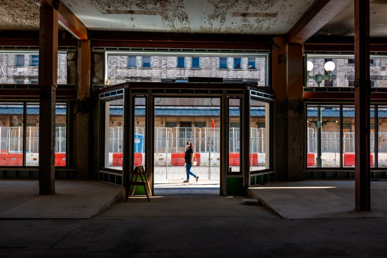 A woman walks past the old entrance to Kline's department store. This space is part of the Zona Cultura which is going through a revitalization to bring new life to W Commerce.