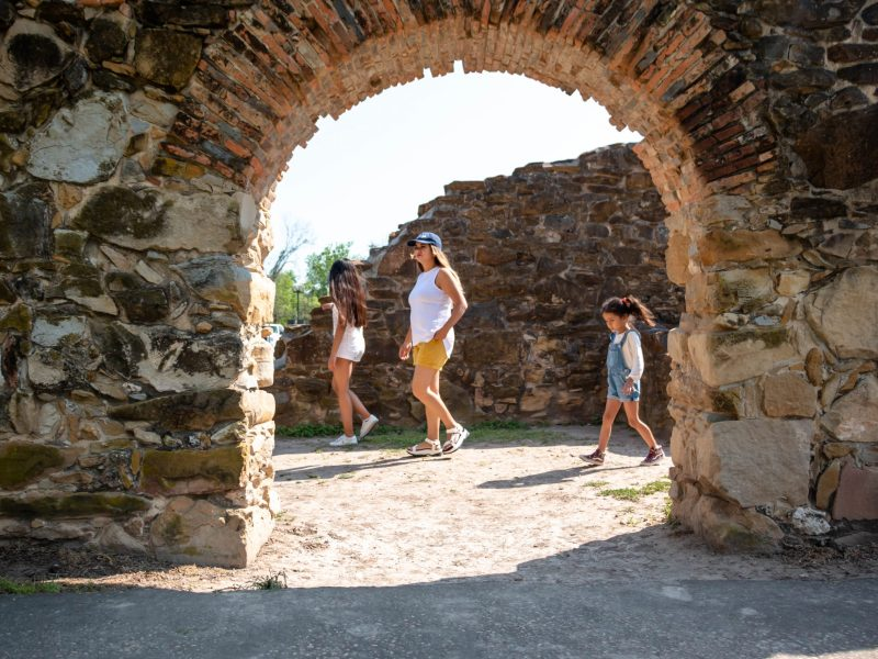 Luisa Garcia explores Mission Espada with her daughters Mia, 10, and Gianna, 6. The 331-year-old mission is located a short drive from their home in Kingsborough Ridge.