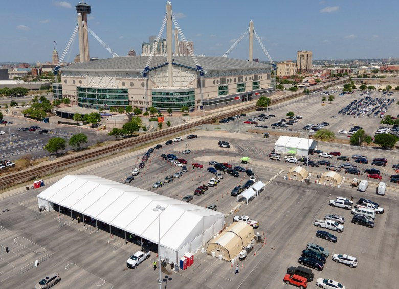 Hundreds of people wait to receive their drive-up vaccination for Covid-19 at the Alamodome on Tuesday.