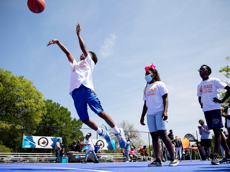 Kids play a game of lightning on a newly dedicated basketball court at the Boys and Girls Club Eastside branch on Thursday. The Nancy Lieberman Charities' Dream Courts program, San Antonio Sports, the John L. Santikos Charitable Foundation and the NCAA teamed up to build the new court near Martin Luther King Park.