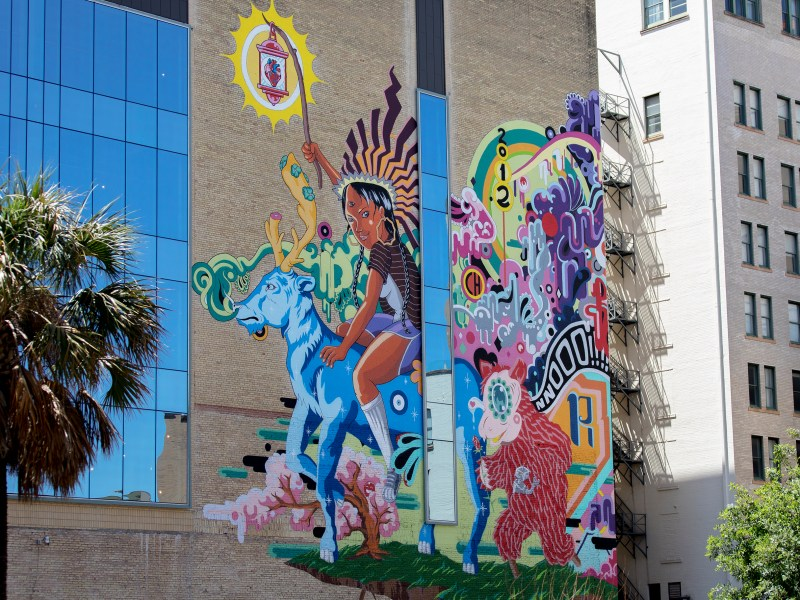 """Muralist Rudy Herrera's """"The Last Parade"""" adorns the nine-story Kress building in downtown on Tuesday."""