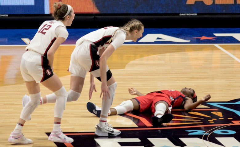 Arizona guard Aari McDonald (2) lays on the court after missing a last-second, go-ahead shot as Stanford forward Cameron Brink (22) and guard Lexie Hull (12) celebrate their victory in the championship game in the women's Final Four NCAA college basketball tournament on Sunday at the Alamodome. Stanford held off an Arizona comeback to win the title, 54-53.