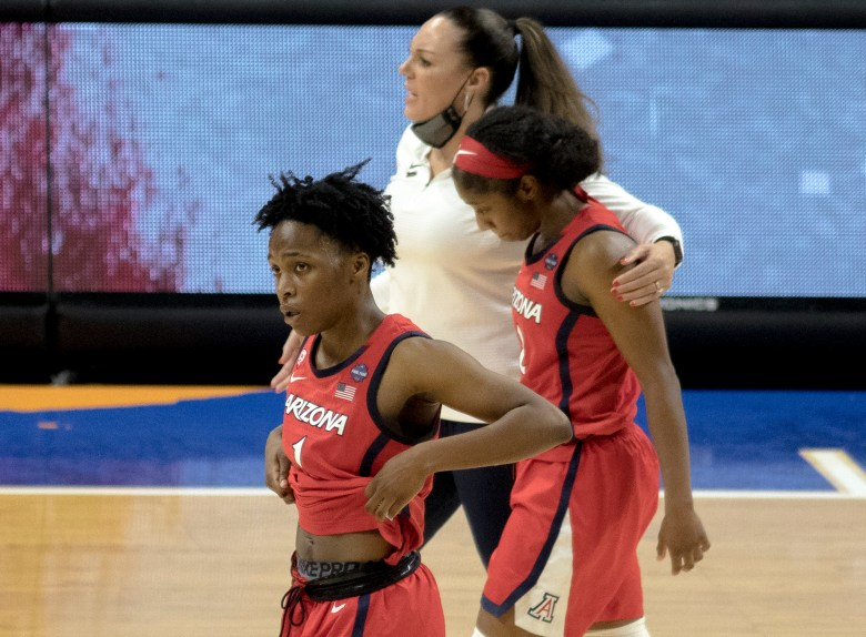 Arizona guard Shaina Pellington (1), guard Aari McDonald (2) and coach Adia Barnes react to losing the championship game in the women's Final Four NCAA college basketball tournament against Stanford on Sunday at the Alamodome. Stanford held off an Arizona comeback to win the title, 54-53.