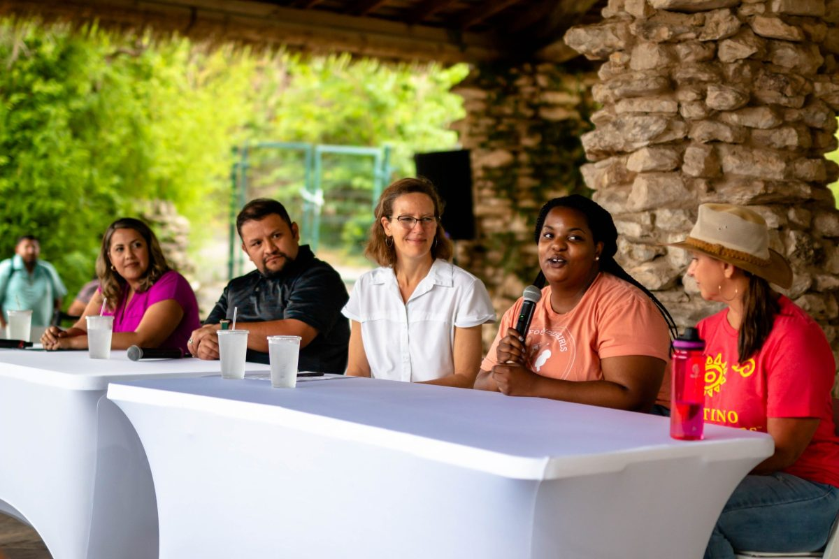 Angelica Holmes (holding the mic), Executive Director of Camp Founder Girls Summer Camp of Black Outside, speaks on the Adult Discussion Panel at the Outside For All event hosted at the Japanese Tea Garden.
