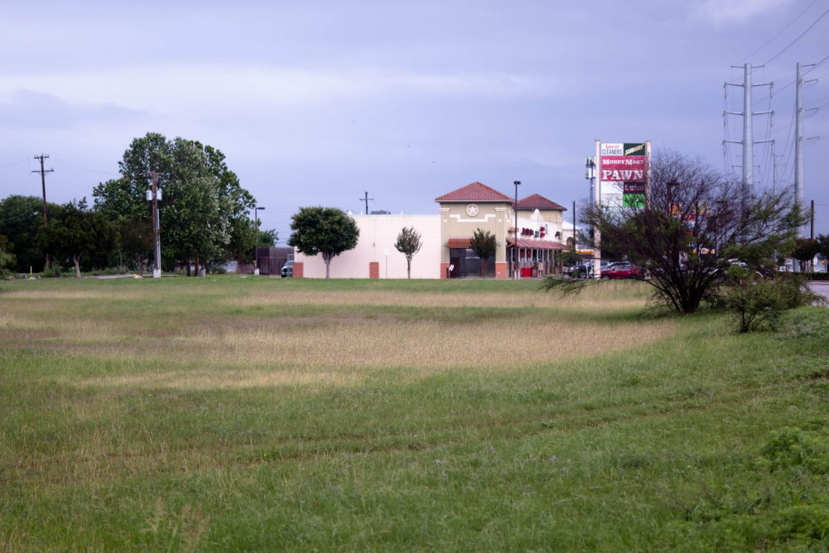 The 24 acres of land slated to become a housing development are adjacent to a small strip mall and a Valero gas station overlooking Southeast Loop 410.