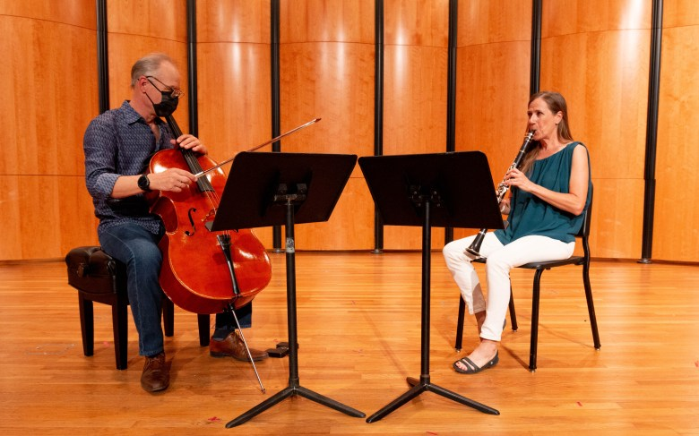 Key and Mollenauer rehearse a piece in the Ruth Taylor Recital Hall at Trinity University, where they are also part of the music staff.
