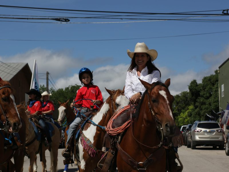 Participants ride horseback during the annual Memorial Day Weekend Parade in Bandera. This event is part of the three-day PCRA-sanctioned Bandera ProRodeo.