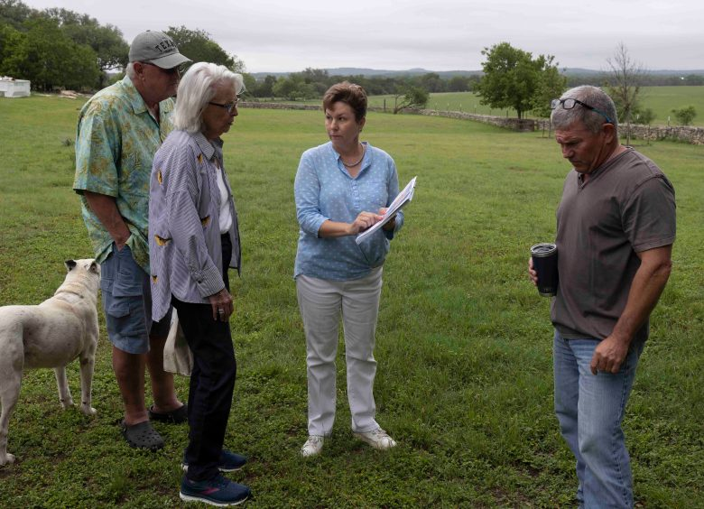 Brenda Chapman, middle, and neighbor Scott Gruendler, right, describe the possibility of SAWS waste water pipelines being routed through their nearly 200 acres of combined aquifer recharge zoned land.