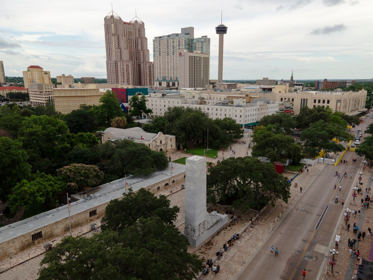 People tour Alamo Plaza during Memorial Day weekend in May. As tourism numbers continue to rebound from the COVID-19 pandemic, the hospitality industry struggles to find employees.
