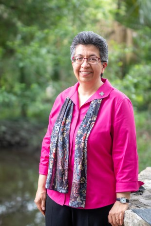 Sister Teresa Maya poses for a portrait in front of the Blue Hole. The Headwaters at the Incarnate Word is a nonprofit ministry of the Sisters of the Incarnate Word.