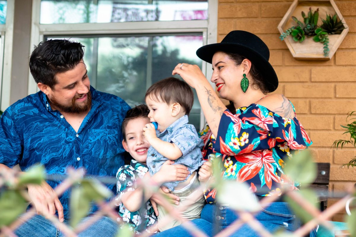 Cristian Acosta (left) sits with his sons, Adrian, 5, and Gabriel, 1, and his wife, Angélica Sánchez. The have called Denver Heights home for eight years.