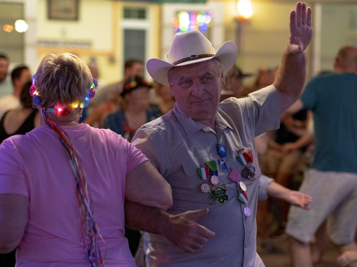 A couple dances to polka music Wednesday during the Fiesta Gartenfest at Beethoven Halle und Garten.