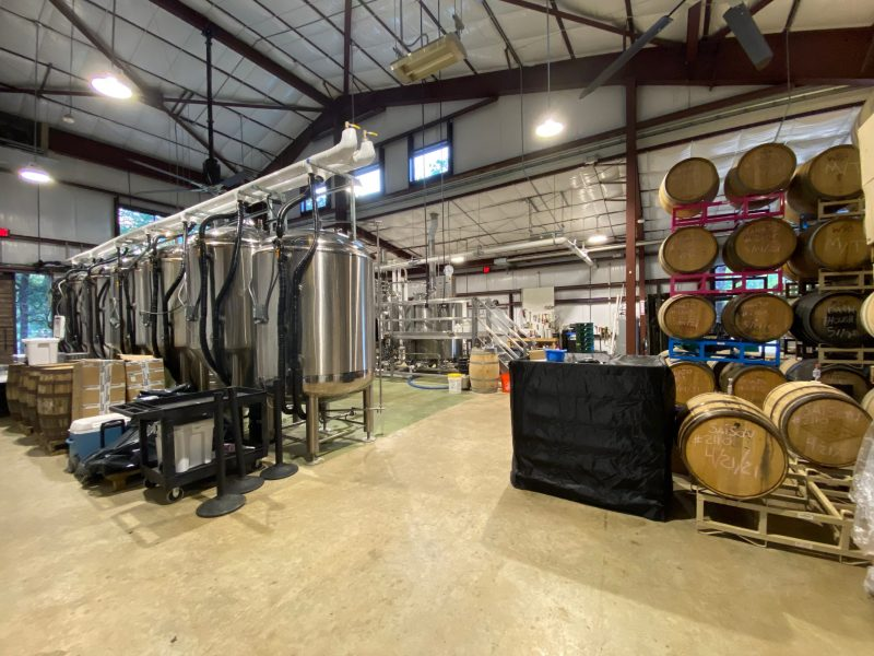 On the left large tanks are busy brewing Vista's beer, and on the right old wine barrels wait to infuse the brews with remnants of it's previous tenant.