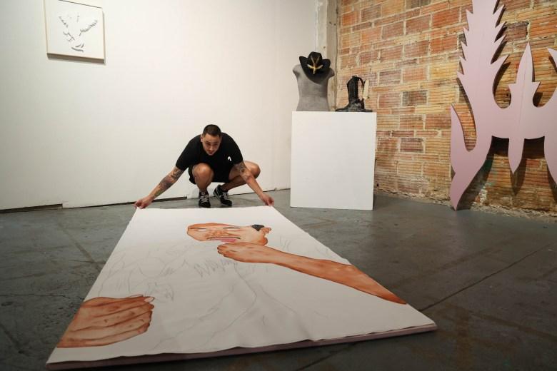 Jose Villalobos arrangers a painting in progress titled Just the tip.