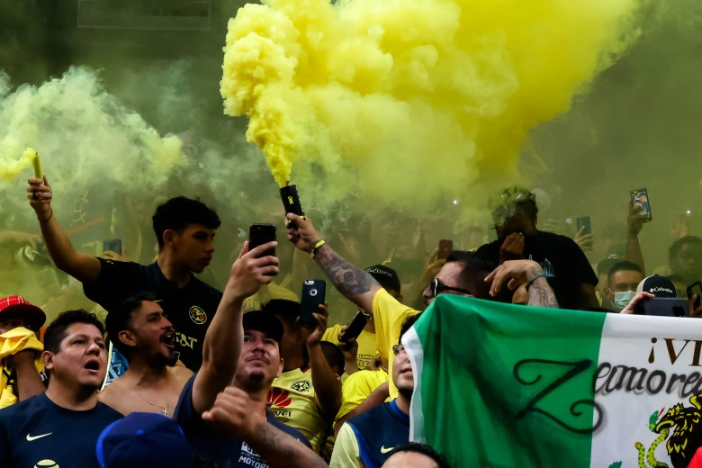 Fans cheering on the Club América team set off smoke bombs in the stands after their team scored during the Liga MX friendly match at the Alamodome , Saturday.