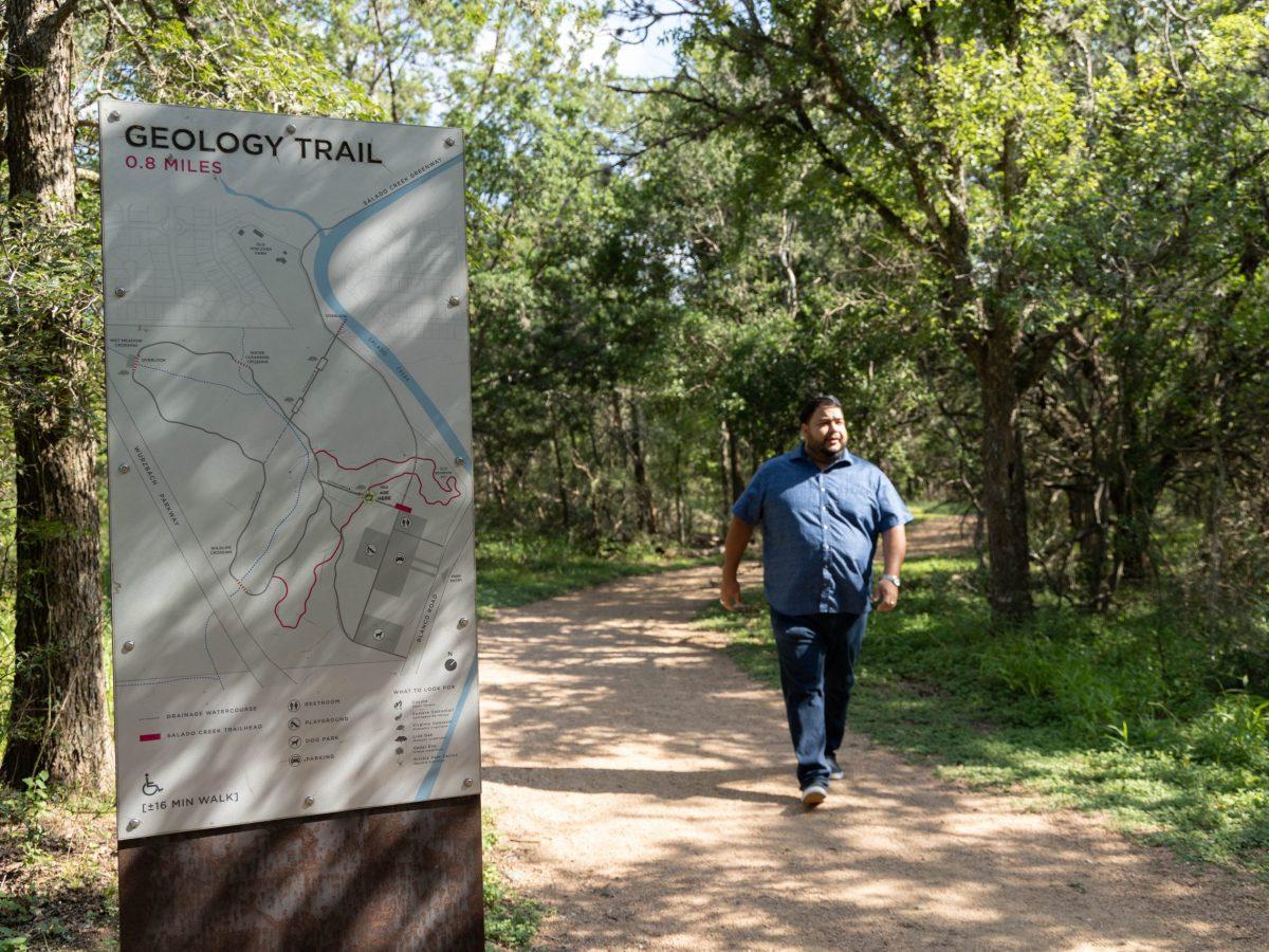 Serna walks along the Geology Trail in Hardberger Park Friday.