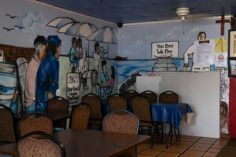 A mural depicts a martitime scene inside of Bayseas in Coverse Thursday.