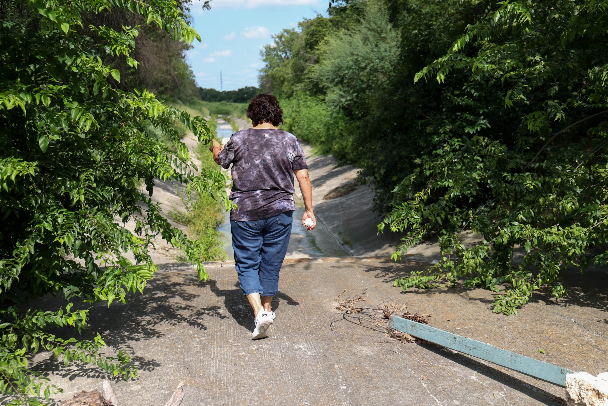 Baca points to where she and her friends used to walk and explore after school in a brushy area adjacent to her childhood home.