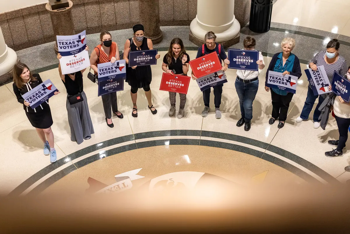 Activists gather outside a Texas Senate committee hearing on proposed election reforms Saturday, July 10, 2021, at the Capitol in Austin.