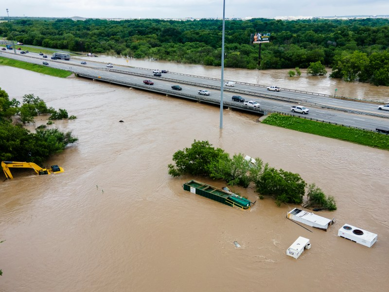 Construction equipment sits in Leon Creek floodwaters near U.S. 90 on Tuesday.