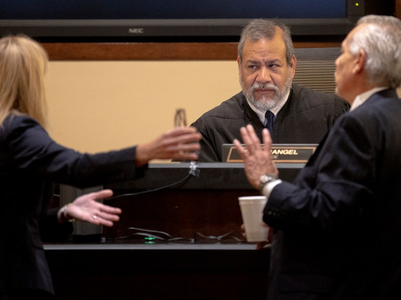 Judge Ron Rangel listens to arguments from prosecutor Tamara Strauch and defense attorney Joel Perez during the capital murder trial of Otis Tyrone McKane on Monday.