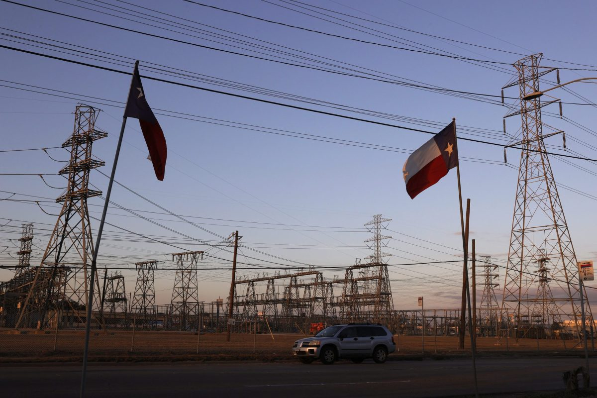 Texas flags fly near an electrical substation in Houston, Texas. Millions of Texans lost their power when winter storm Uri hit the state and knocked out coal, natural gas and nuclear plants that were unprepared for the freezing temperatures brought on by the storm. Wind turbines that provide an estimated 24 percent of energy to the state became inoperable when they froze.