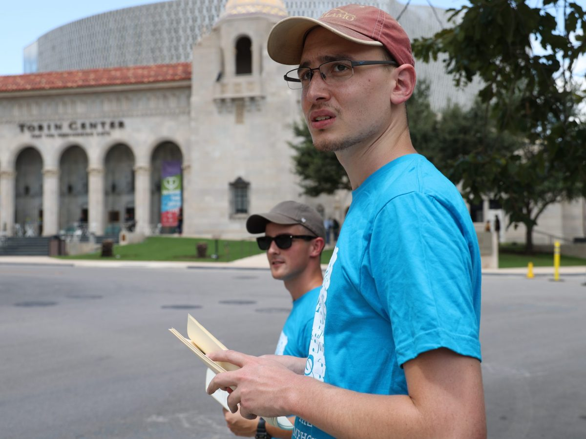 Derek Mitchell (right), bass trombonist for the San Antonio Symphony, and James Seymour, second trombone, hand out leaflets explaining the pay cut the symphony is facing to guests arriving for the Tobin Center Open House Saturday.
