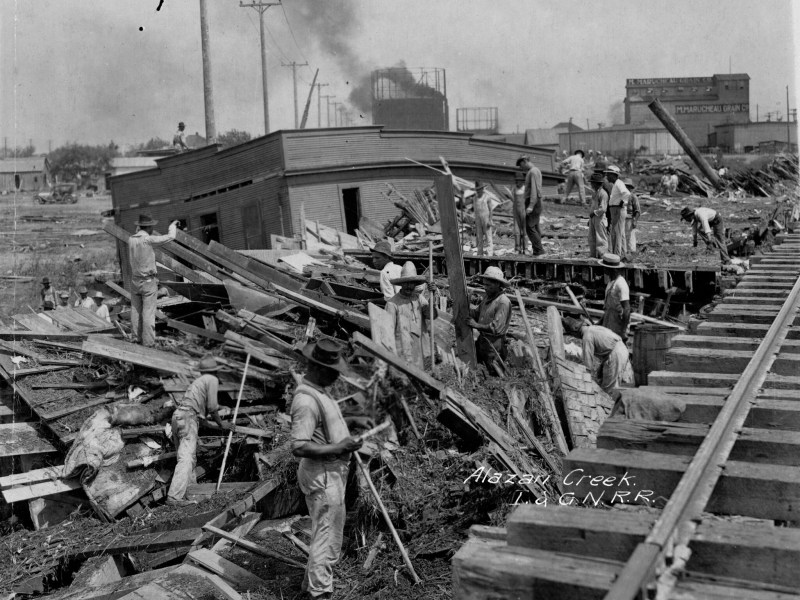 Destruction caused by the historic flood of 1921 left homes, businesses, and over 80 people dead along the Alazon Creek in the city's Westside.