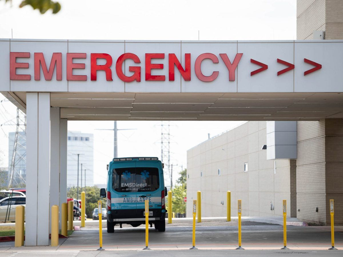 An ambulance sits outside of the Emergency Room entrance at Methodist Stone Oak Hospital Wednesday.