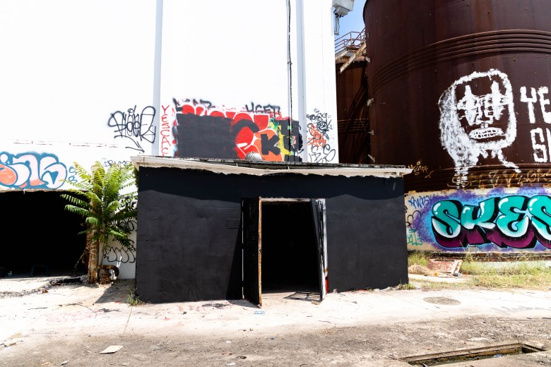 """The structure where Martinez displayed his photography is now painted black after being """"buffed"""" by other graffiti artists."""