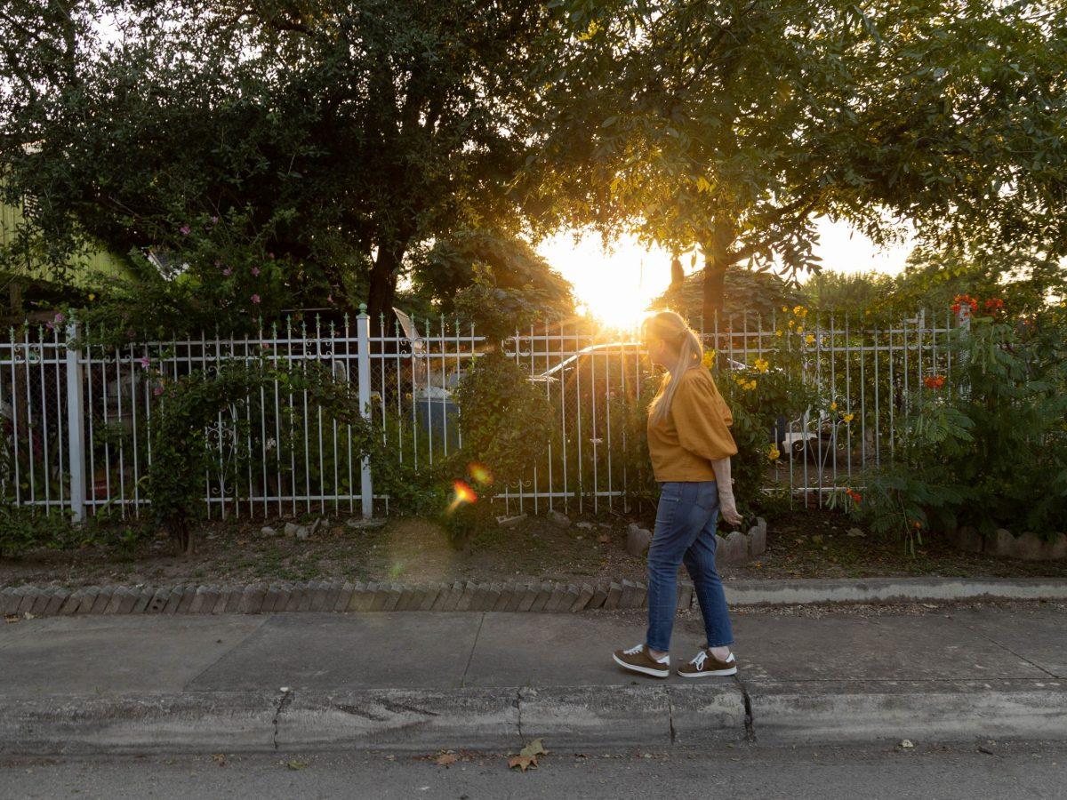 Peña admires animal-shaped hedges made by her neighbor Juan Melendez.