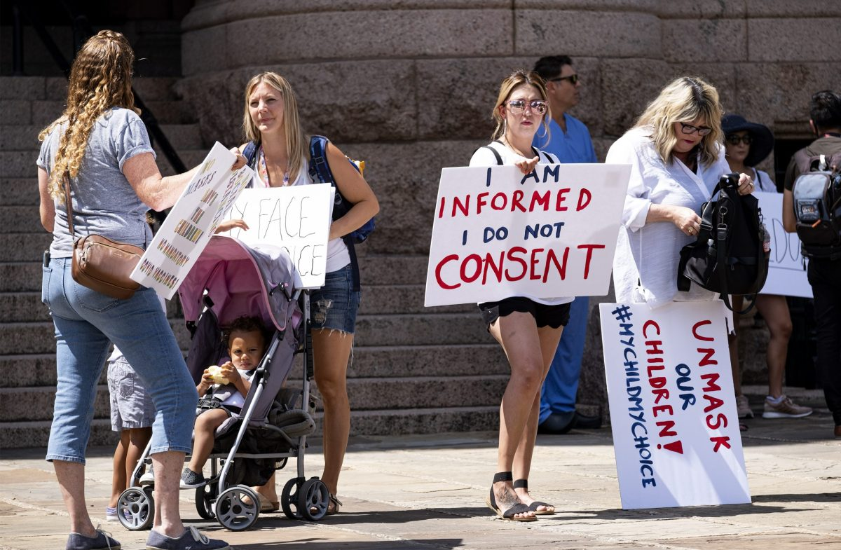 Protesters of mask mandates gather outside the Bexar County Courthouse on Friday.