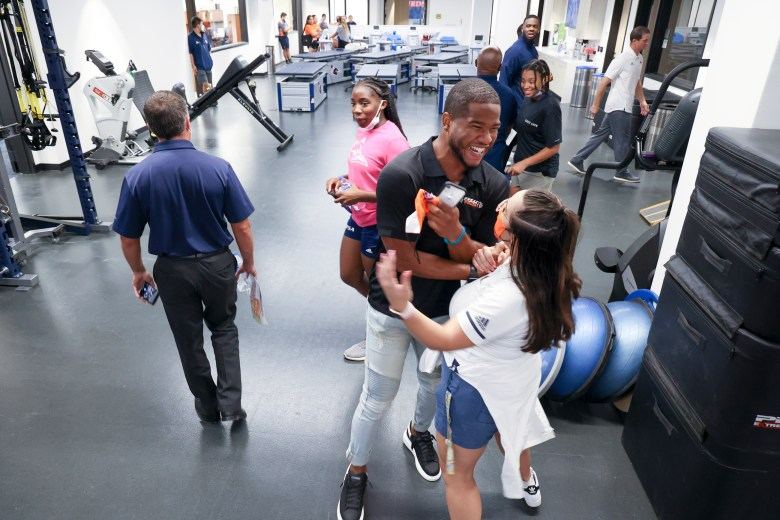 UTSA Quarterback Frank Harris embraces with fellow UTSA students at the opening of the Roadrunner Athletic Center of Excellence.