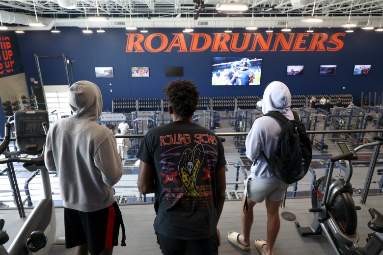 UTSA student athletes overlook the weight facility at the Roadrunner Athletic Center of Excellence.
