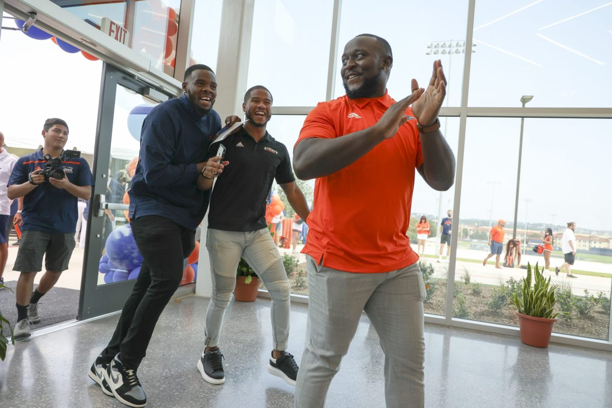 UTSA football players (from right) Myles Benning, Frank Harris, and Leroy Watson walk into the Roadrunner Athletics Center of Excellence (RACE) for the first time on Wednesday August 4th, 2021.