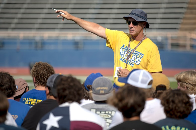 Alamo Heights head football coach Ron Rittimann speaks with his team following a practice at Harry B. Orem stadium on Thursday.
