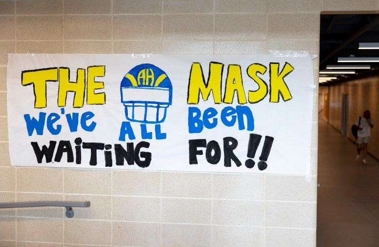 A COVID-19-themed sign covers a wall leading to the football field at Harry B. Orem stadium on Thursday.