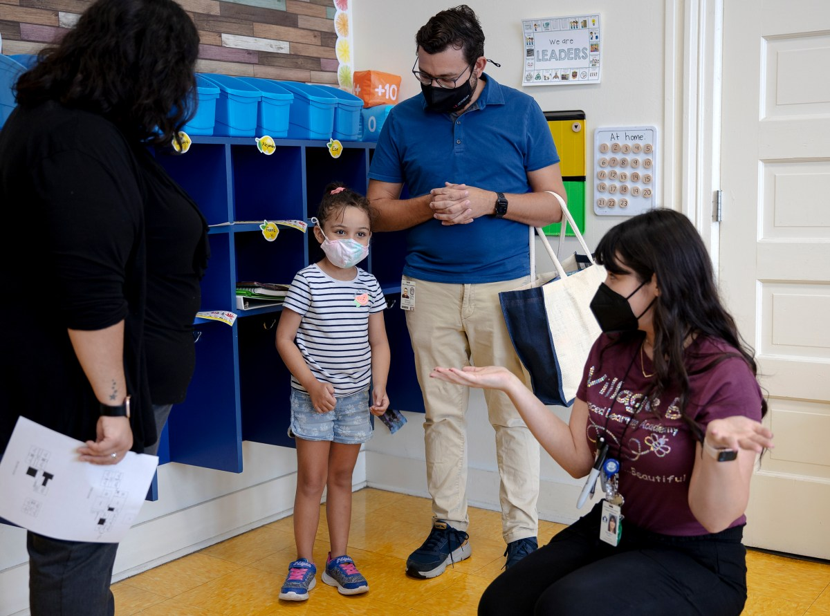 Isabella Polasek meets her new teacher, Ellen Hart, with her parents, Randall Polasek and Sabrina Macal-Polasek during a back to school event at Advanced Learning Academy on Thursday.