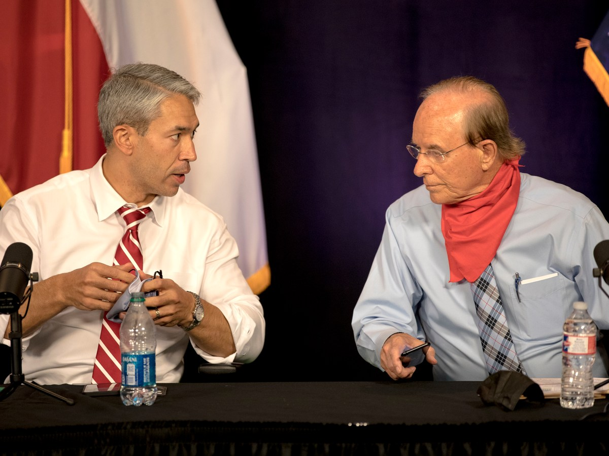 Mayor Ron Nirenberg, left, talks to Bexar County Judge Nelson Wolff before a COVID-19 briefing on Tuesday.