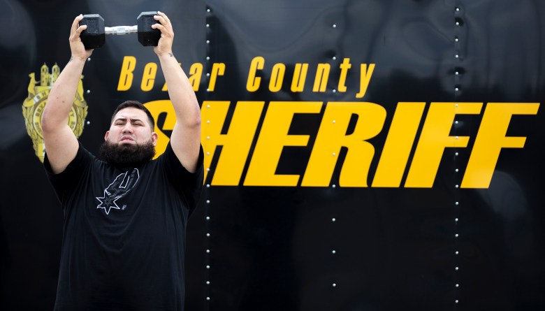 John Benitez completes a portion of the fitness test during a recruitment event hosted by the Bexar County sheriff's office in August.