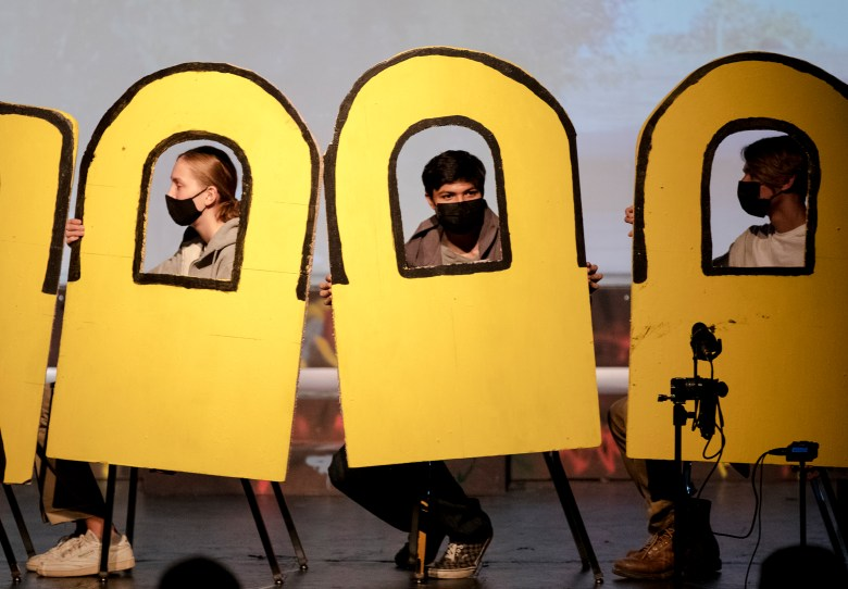 Julian Perez, center, portraying Young Lorenzo, acts during a performance of Tafolla Toro: Three Years of Fear at the Guadalupe Cultural Arts Center on Friday.