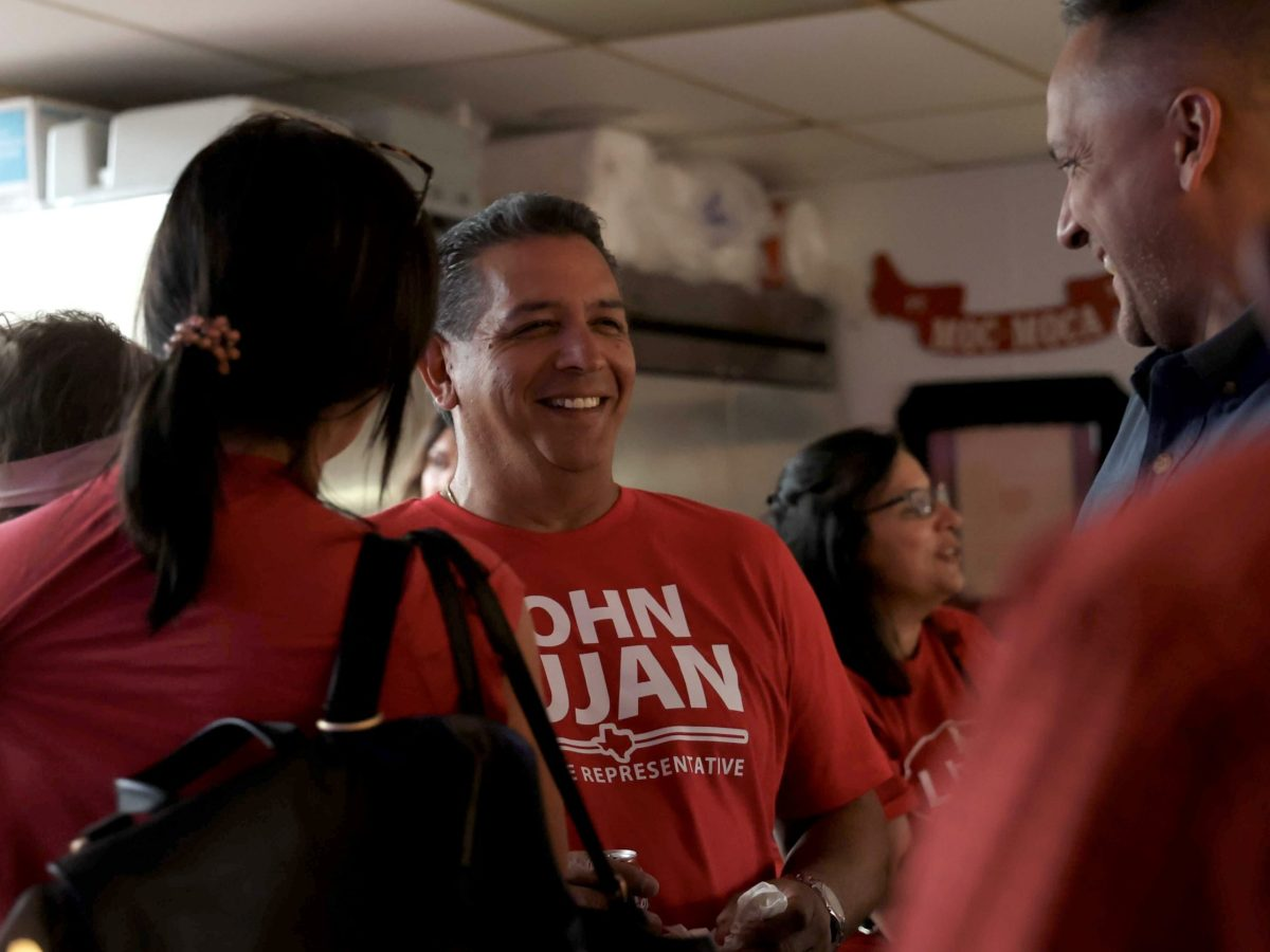 Texas House District 118 candidate John Lujan, center, is in high spirits after claiming a majority of the early vote totals. Also pictured is former councilman and mayoral candidate Greg Brockhouse, right.