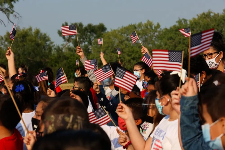 Students at Heritage Elementary School wave American flags in remembrance of the victims and heroes of 9/11 on Friday September 10th, 2021.