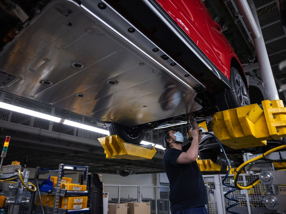 An employee secures a battery pack to the chassis of a Hyundai Kuna electric sport utility vehicle on the assembly line at the Hyundai Motor Co. plant in Nosovice, Czech Republic, on Wednesday, April 7, 2021. With Europe expected to lead the world in electric-car sales for a second straight year, an epic rush to build a battery-supply chain from scratch is playing out across the continent. Photographer: Milan Jaros/Bloomberg via Getty Images