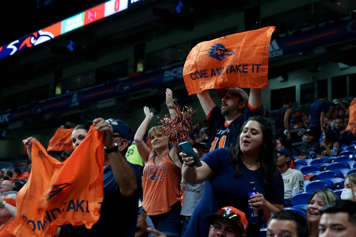 """Fans wave """"Come and take it"""" flags at the USTA home opener against Lamar Saturday."""