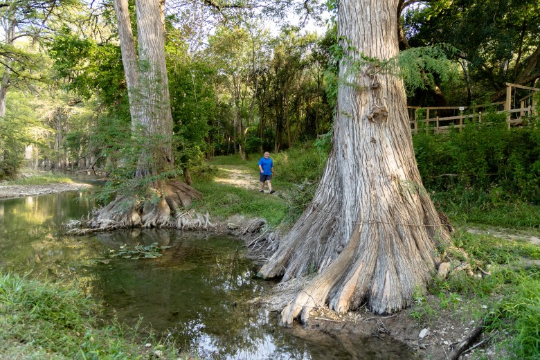 Briery walks through his favorite spot in the campsite along the Guadalupe River Tuesday.