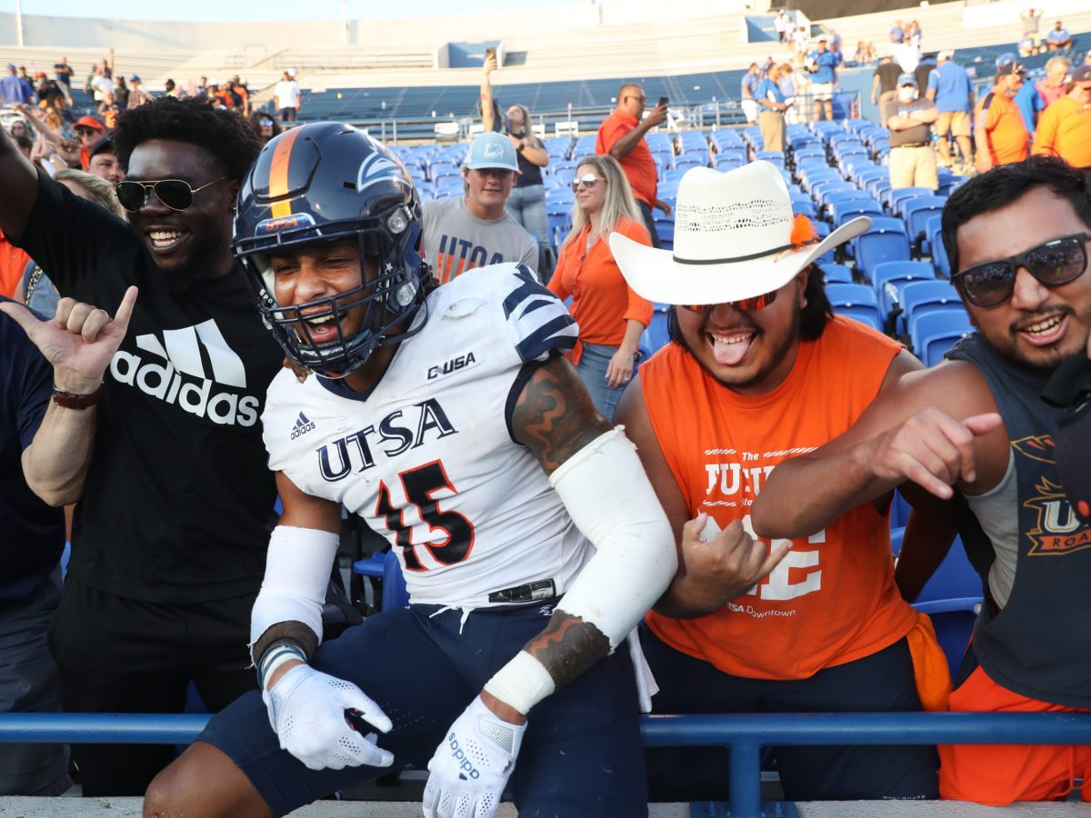 UTSA linebacker Trevor Harmanson celebrates in the stands with fans after their 31-28 win over the Memphis Tigers at Liberty Bowl Memorial Stadium on Saturday, September 25, 2021.