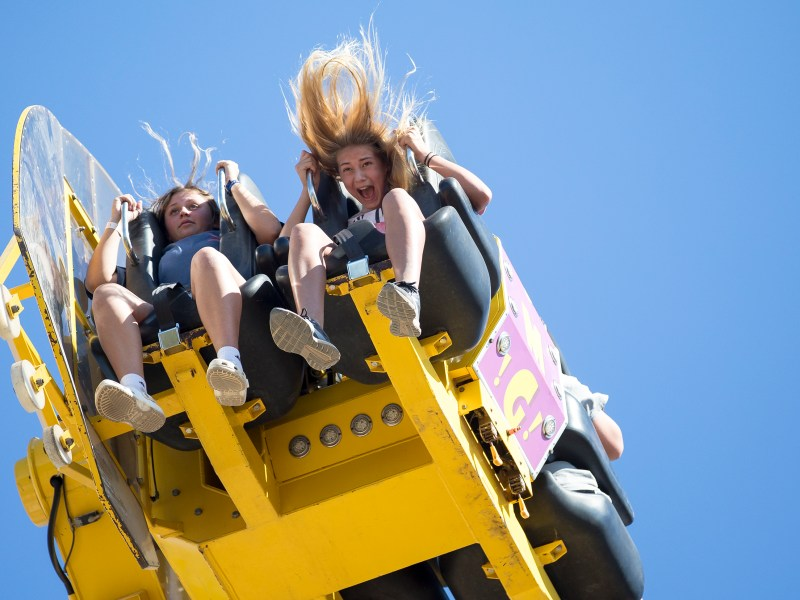 Jordyn Nabors, left, and Holly Hollon scream while riding a carnival ride during the Comal County Fair in New Braunfels on Sunday.